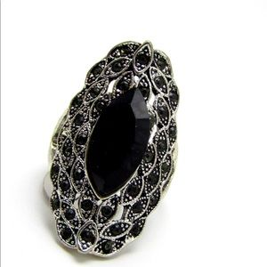 Black marquise stones on large silver tone ring